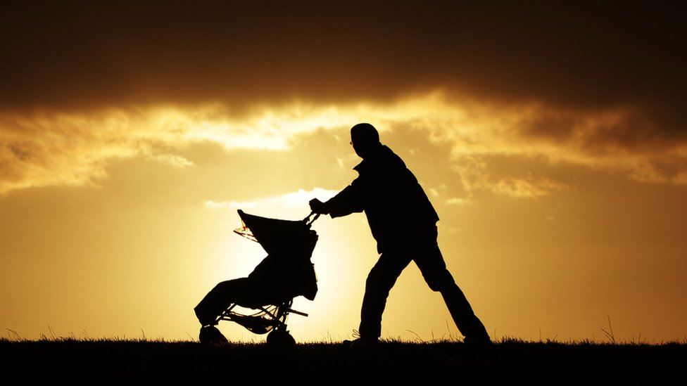 A single parent with a child in a pushchair