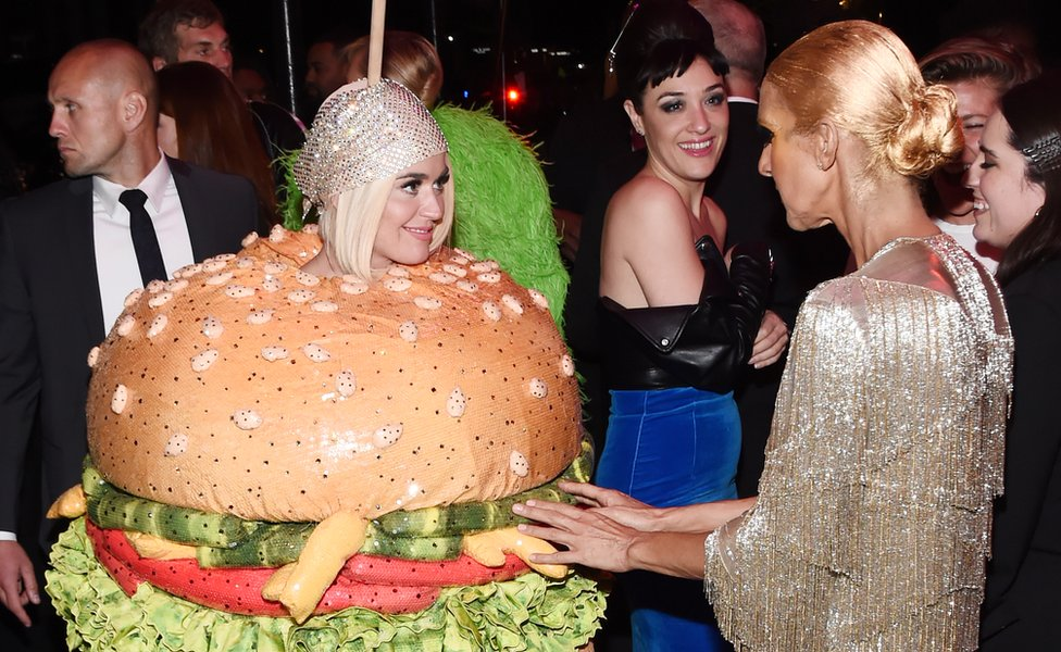 Katy Perry dressed as a beef burger at the 2019 Met Gala, with Celine Dion