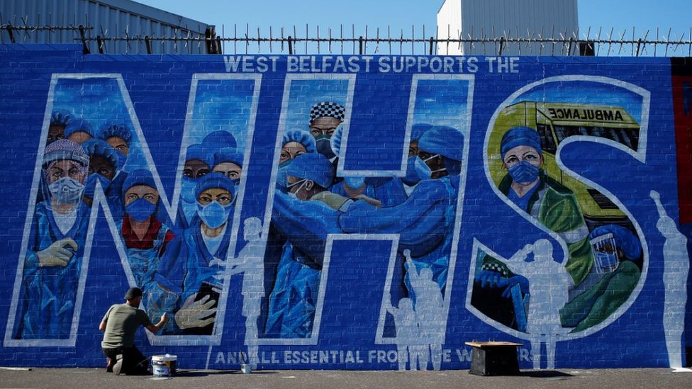 Artist Marty Lyon working on the tribute mural he and Micky Doherty (not pictured) created to honour NHS staff and key workers in west Belfast
