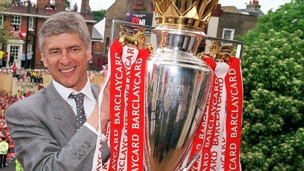Arsene Wenger holds Premier League trophy