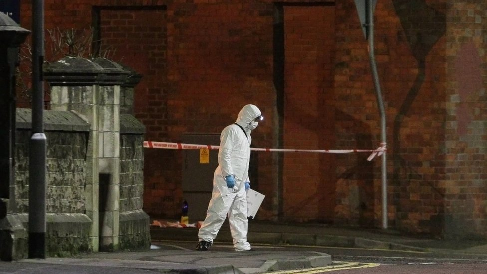 A forensic officer at the scene in Coleraine where two women were stabbed