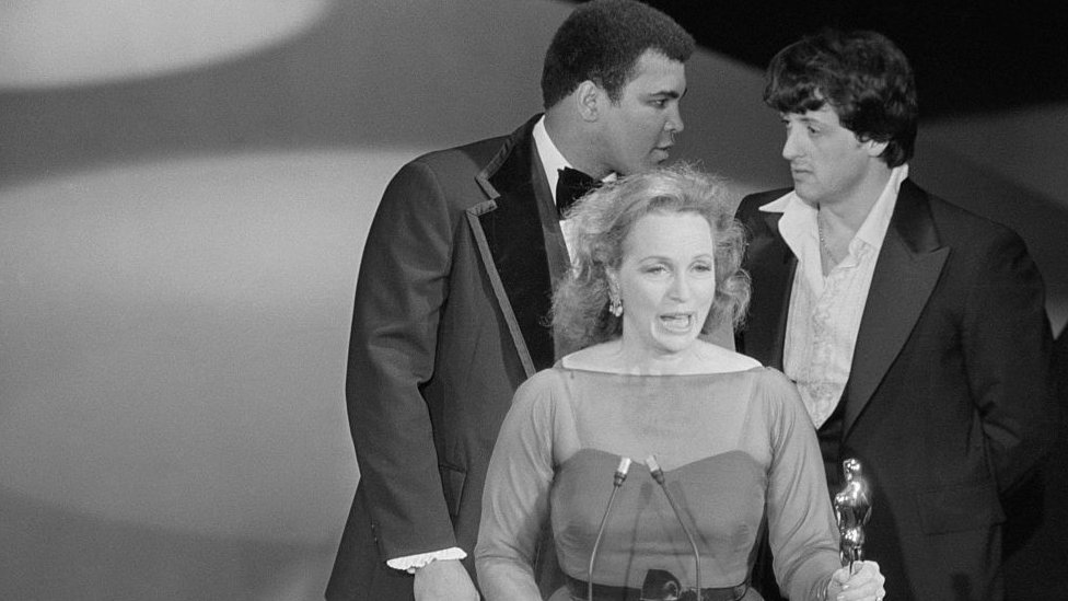 Flanked by Muhammad Ali and Sylvester Stallone, Beatrice Straight makes her speech after winning the Oscar in 1977