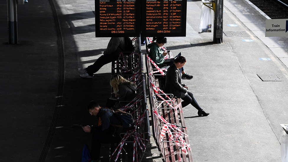 Rail passengers on the platform at Clapham Junction station