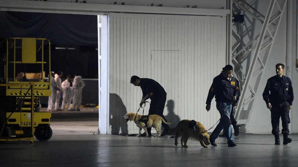 Police with their dogs are seen at the Costa Salguero event venue in Buenos Aires.