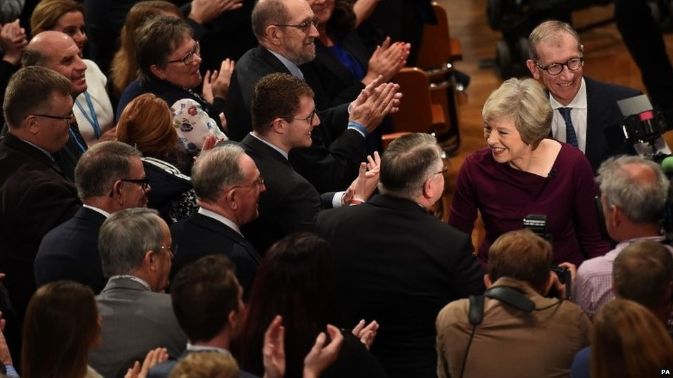 Theresa May is greeted by supporters after the speech