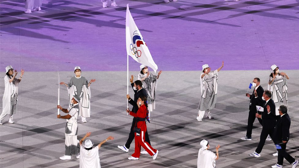 The flag bearers of the Russian Olympic Committee (ROC) Sofya Velikaya and Maxim Mikhaylov enter the stadium during the Opening Ceremony of the Tokyo 2020 Olympic Games at the Olympic Stadium in Tokyo, Japan, 23 July 2021.
