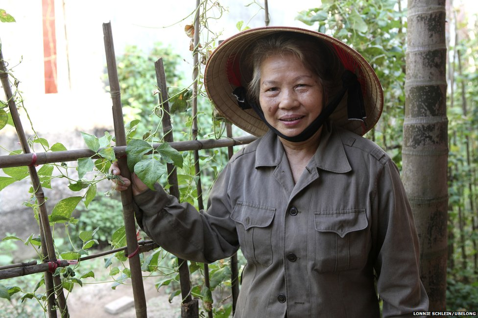 Tran Thi Thon, 66, at the garden of a neighbor's home in Hai Duong