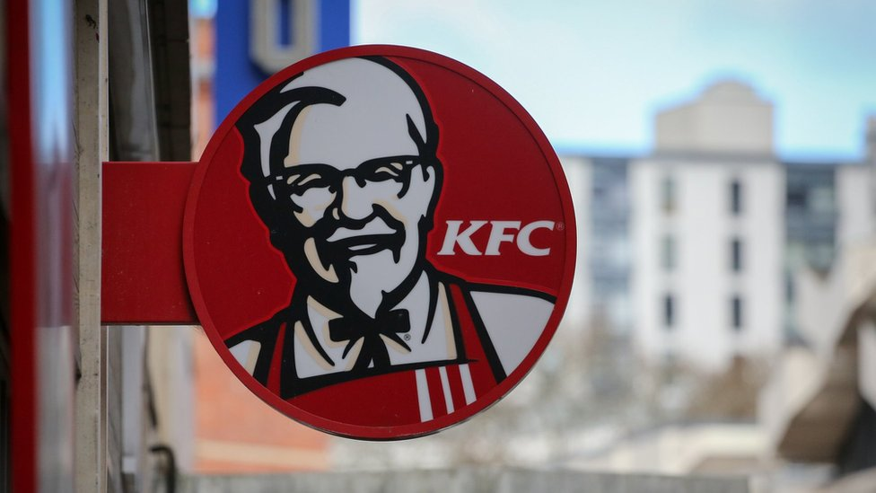 The logo of KFC displayed outside of a branch closed due to a chicken shortage