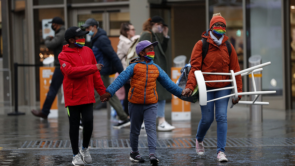 People wearing rainbow masks in Nottingham on 29 October