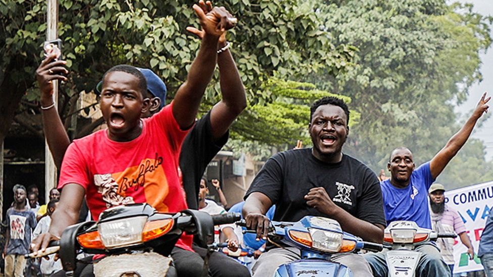 People on motorbikes in Bamako celebrating the military takeover in Mali - August 2020