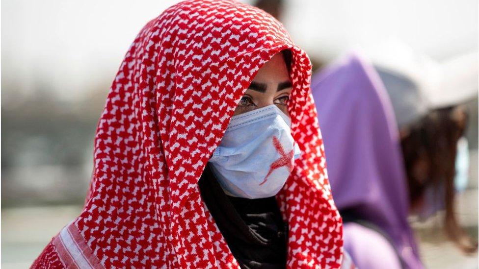 متظاهرة عراقية يوم المرأة العالمي 2021