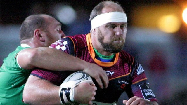 Rynard Landman of Dragons is tackled by Treviso's Davide Giazzon