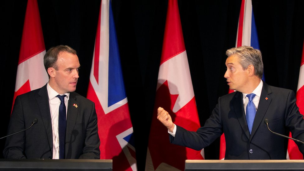 Dominic Raab (left) and Canada's Foreign Minister Francois-Philippe Champagne at a news conference in Montreal