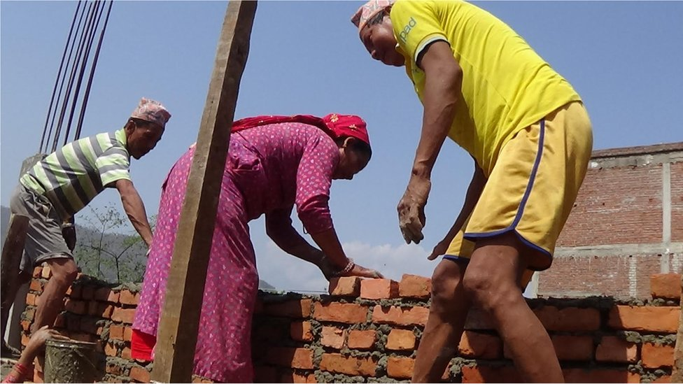 Sanumaya Kumal and men working at the building site at Bidur in Nuwakot district