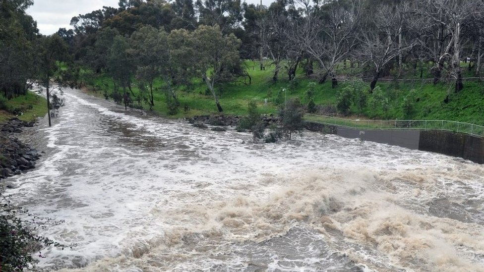 A general view shows floodwater surging down the River Torrens in Adelaide, South Australia, Australia, 29 September 2016.