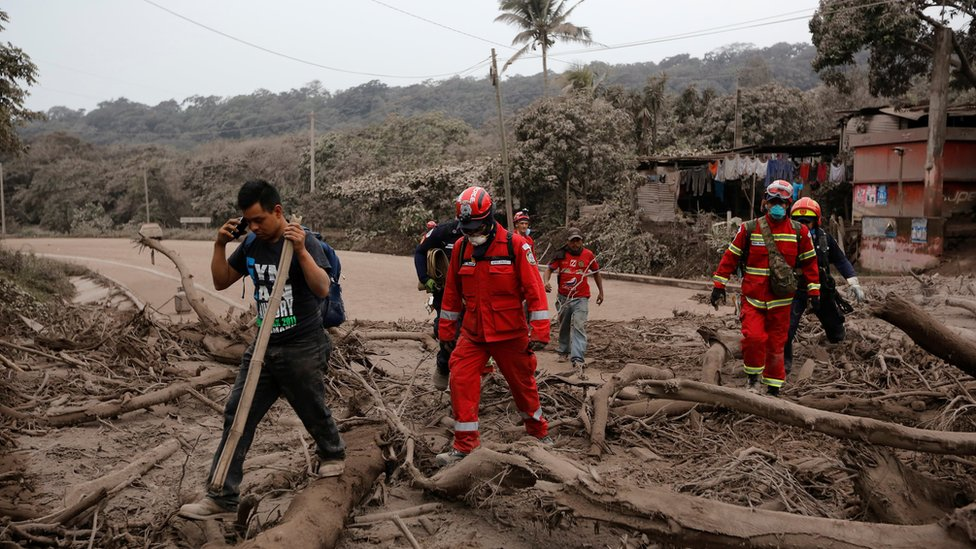 Firefighters tour an area affected by the eruption of the Fuego volcano as they look for bodies or survivors in the community of San Miguel Los Lotes in Escuintla, Guatemala, June 4, 2018