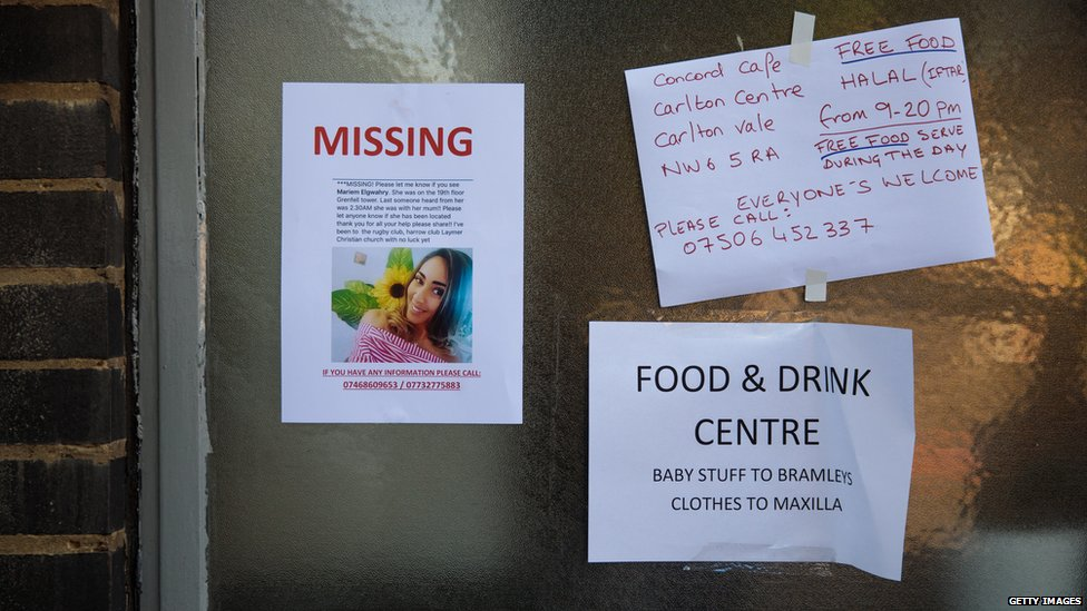 A missing persons poster sits on a community centre near to the site of the Grenfell Tower fire