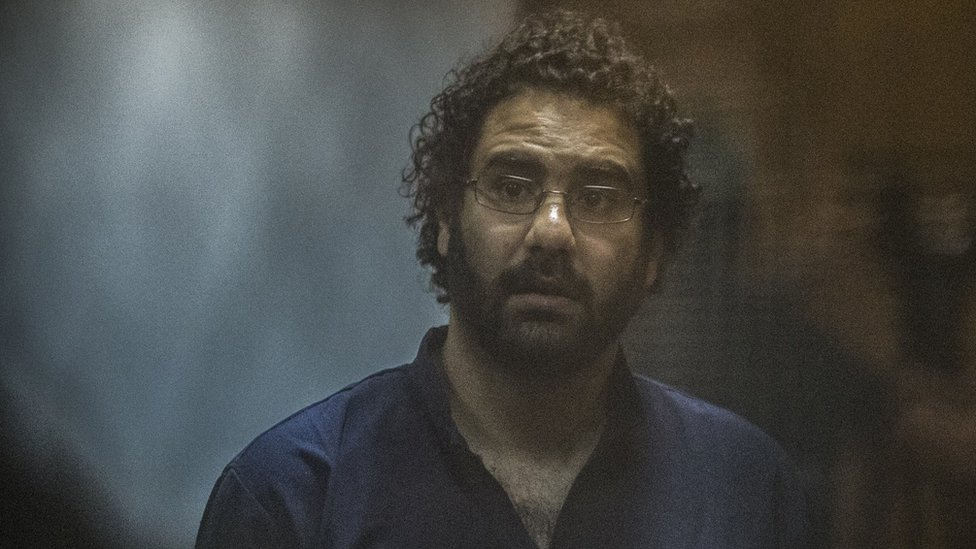 File photo showing Alaa Abdel Fattah in court in March 2015
