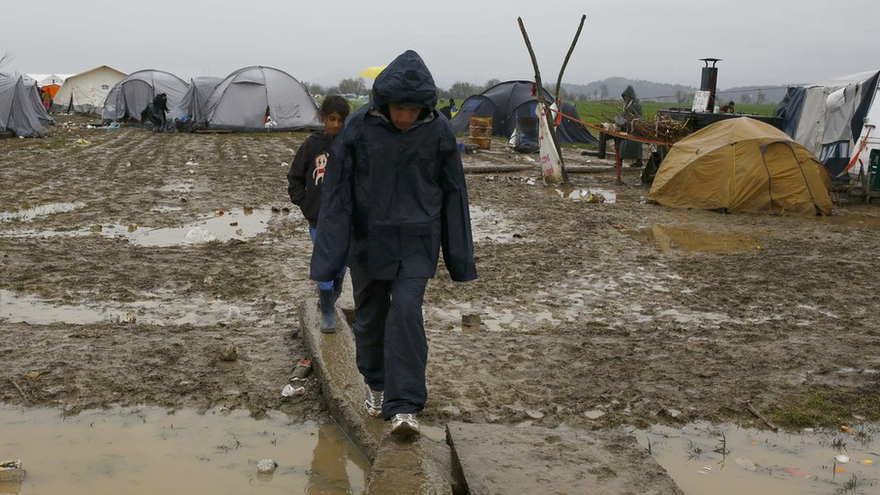 Boys walk at Idomeni camp near the Greek border with Macedonia