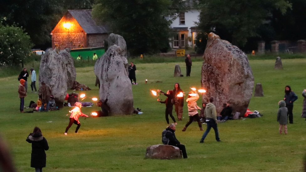 Revellers celebrate the Summer Solstice, despite official events being cancelled amid the spread of the coronavirus disease (COVID-19), in Avebury