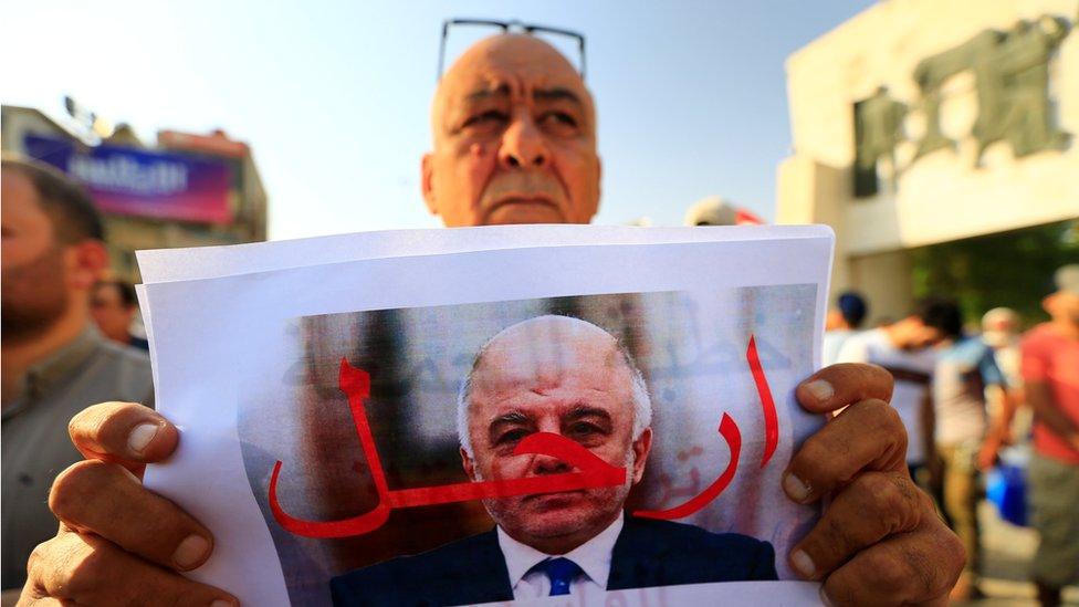 متظاهر في ساحة التحرير في بغداد الجمعة 27/7/2018