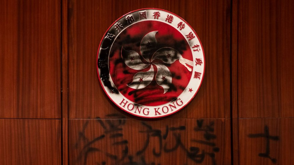 Hong Kong emblem defaced by a graffiti during the demonstration.
