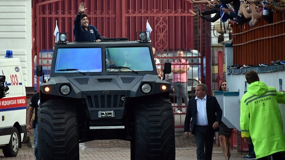 Maradona riding an all-terrain vehicle in Belarus