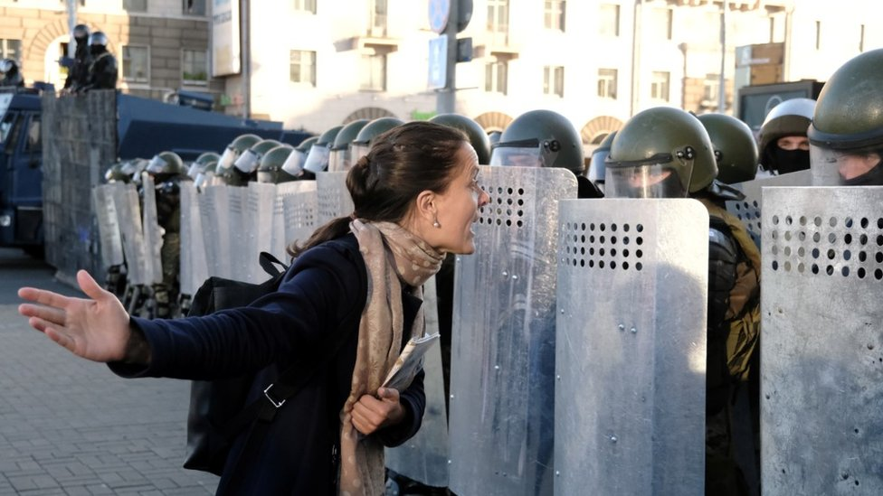 Protester confronting riot police in Minsk, 20 Sep 20