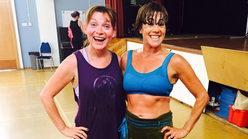 Lorraine Kelly and her trainer doing exercise
