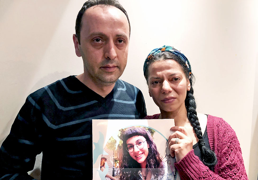 Yaren's parents hold a poster of the student, detained last month in Istanbul