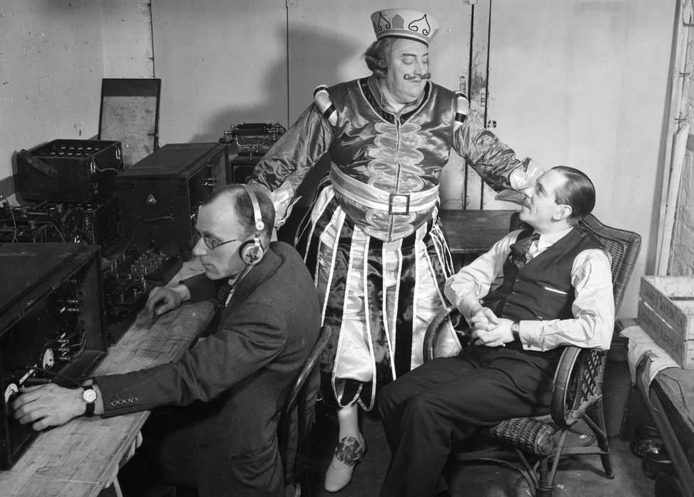 Picture shows an outside broadcast from the Drury Lane Theatre of Jack and the Beanstalk. (l-r) an engineer with gear, Clifford hatherley and John Watt.