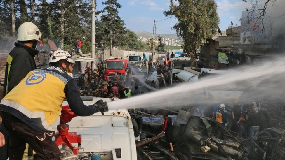 First responders from Syria Civil Defence put out a fire after a reported truck bomb attack in Afrin, north-western Syria, on 28 April 2020
