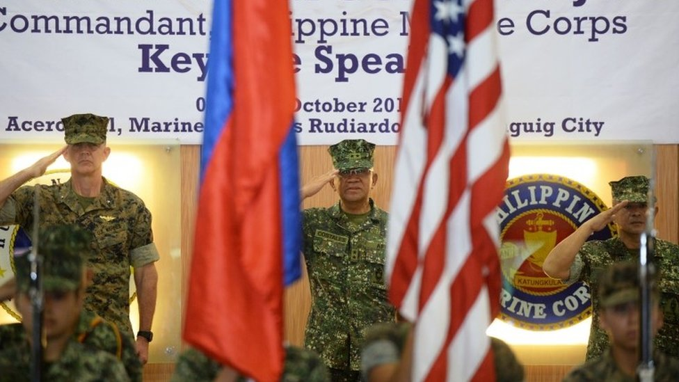 US marines Brigadier General John Jansen (L), Philippines marines Major General Andre Costales (C) and Brigadier General Maximo Ballesteros salute during the opening ceremony of the Amphibious Landing Exercise (PHIBLEX) at the marines headquarters in Manila on October 4, 2016.
