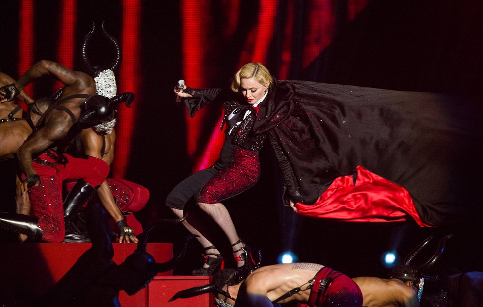 Madonna falls as she performs on stage for the BRIT Awards 2015 at The O2 Arena in 2015 in London