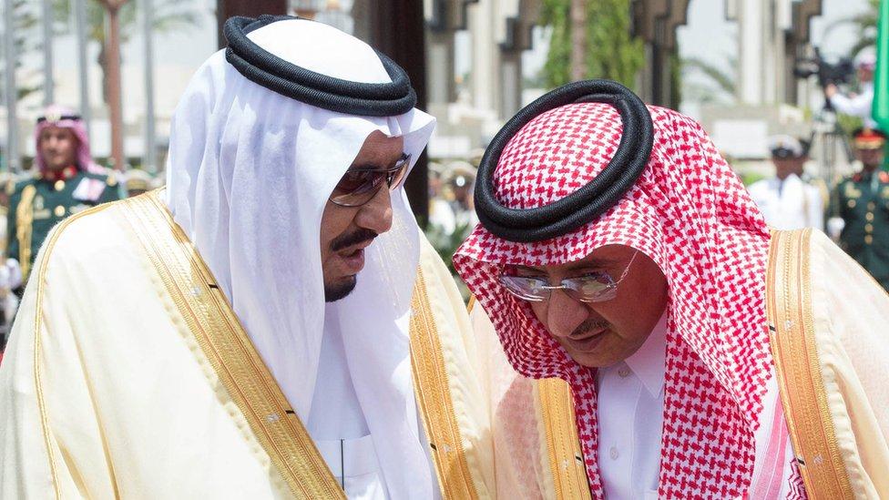 Saudi Arabia's King Salman bin Abdul Aziz Al Saud speaks with Crown Prince Mohammed Bin Nayef during a reception ceremony in Jeddah