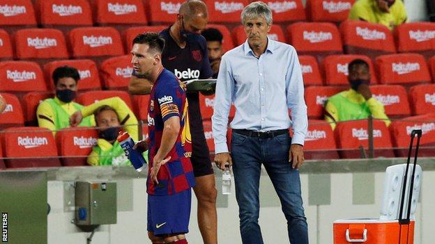 Lionel Messi and Quique Setien