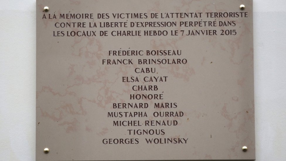The plaque unveiled outside Charlie Hebdo's offices