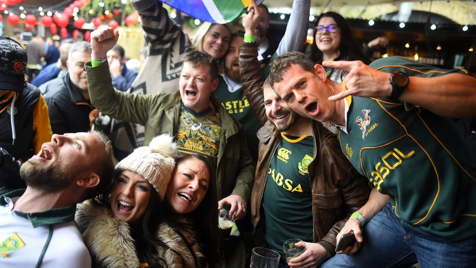 South Africa rugby fans celebrate their win at Flat Iron Square in London