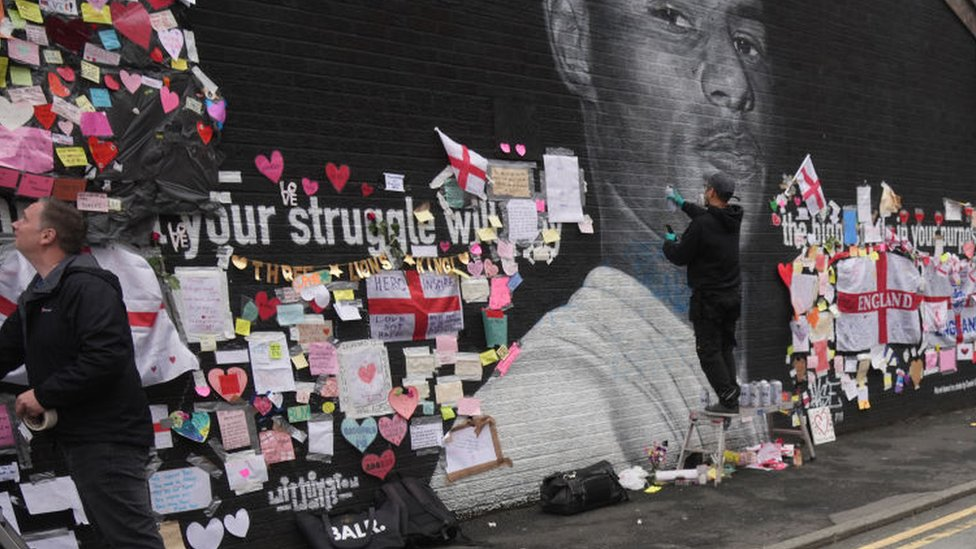Artist repairs defaced mural of Marcus Rashford