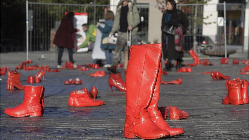 Shoes painted in red are placed on the ground to symbolise victims of femicide as part of an exhibition to condemn all kinds of violence toward women, in Square Jourdan, in the European district of Brussels, Belgium, 25 November 2019.