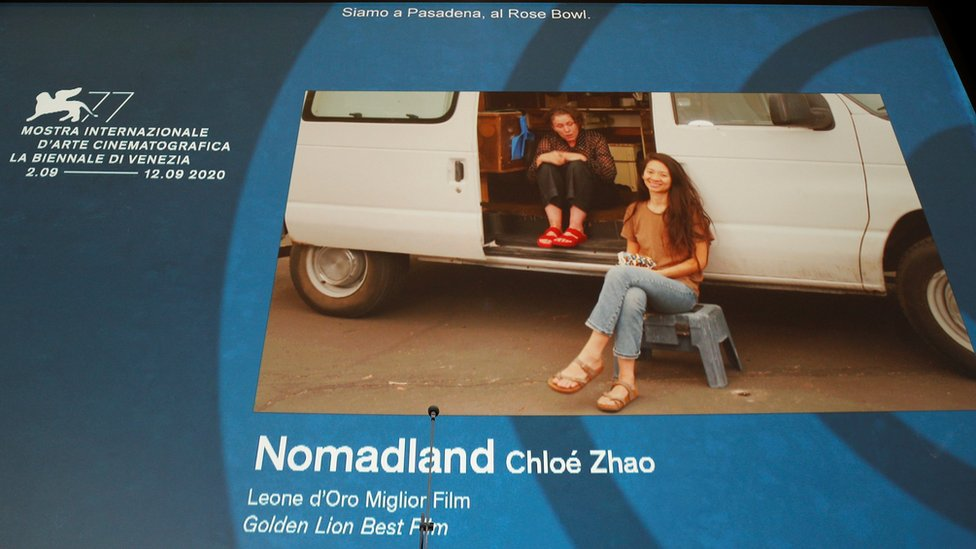 Director Chloe Zhao and actor Frances McDormand accept the Golden Lion - via Zoom - for Nomadland