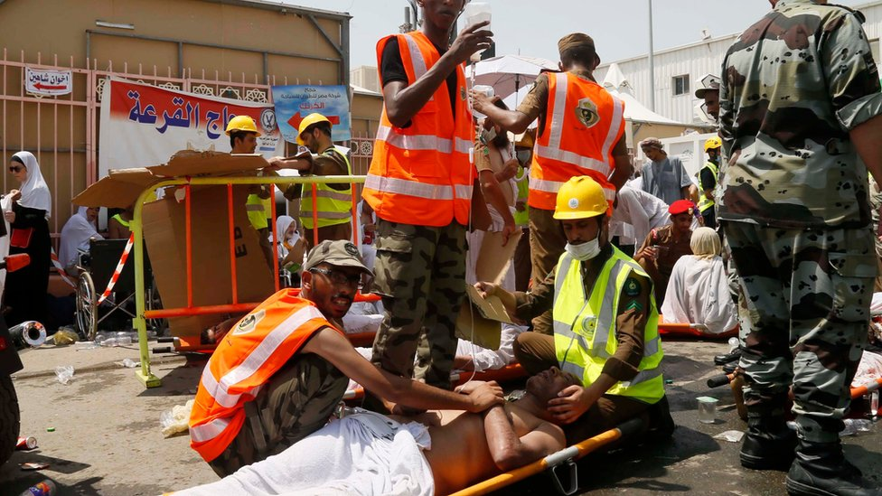 Saudi rescue workers attend to pilgrims injured in a stampede in Mina, Saudi Arabia, during the 2015 Hajj (24 September 2015)