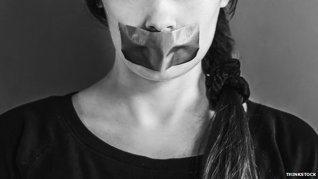 Woman with mouth taped over