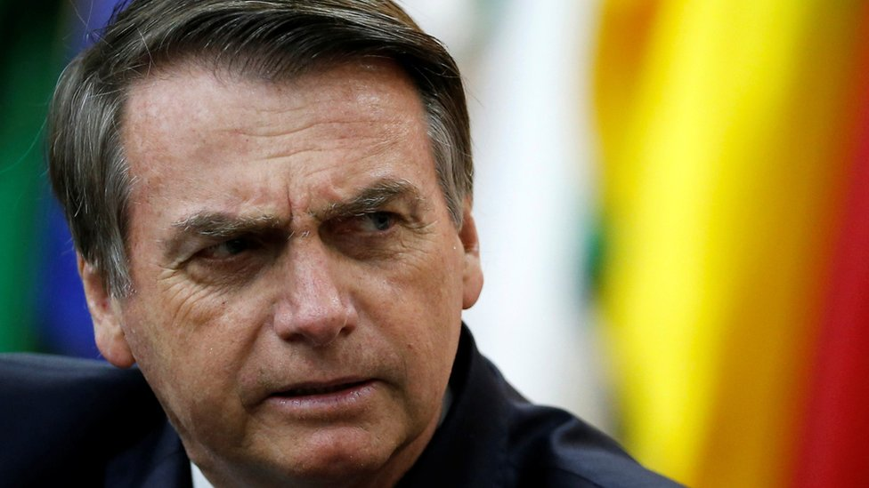 Brazil's President Jair Bolsonaro looks on during a National Soccer Day Ceremony in Brasilia