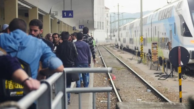 Migrants on platform at Vienna's Westbahnhof station as they wait to see whether trains will take them any further west towards Germany