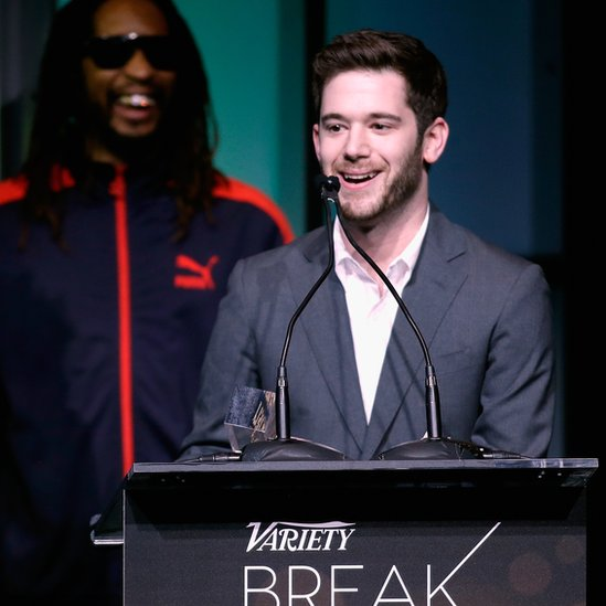 Honoree Colin Kroll (R) accepts the Breakthrough Award for Emerging Technology from rapper Lil Jon onstage at the Variety Breakthrough of the Year Awards
