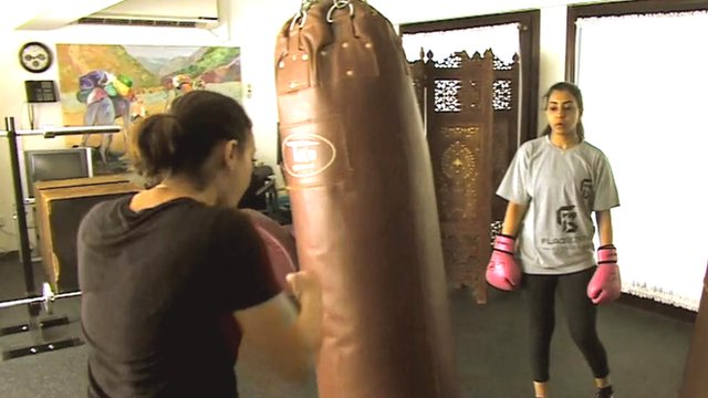 Women kick-boxing in Saudi Arabia