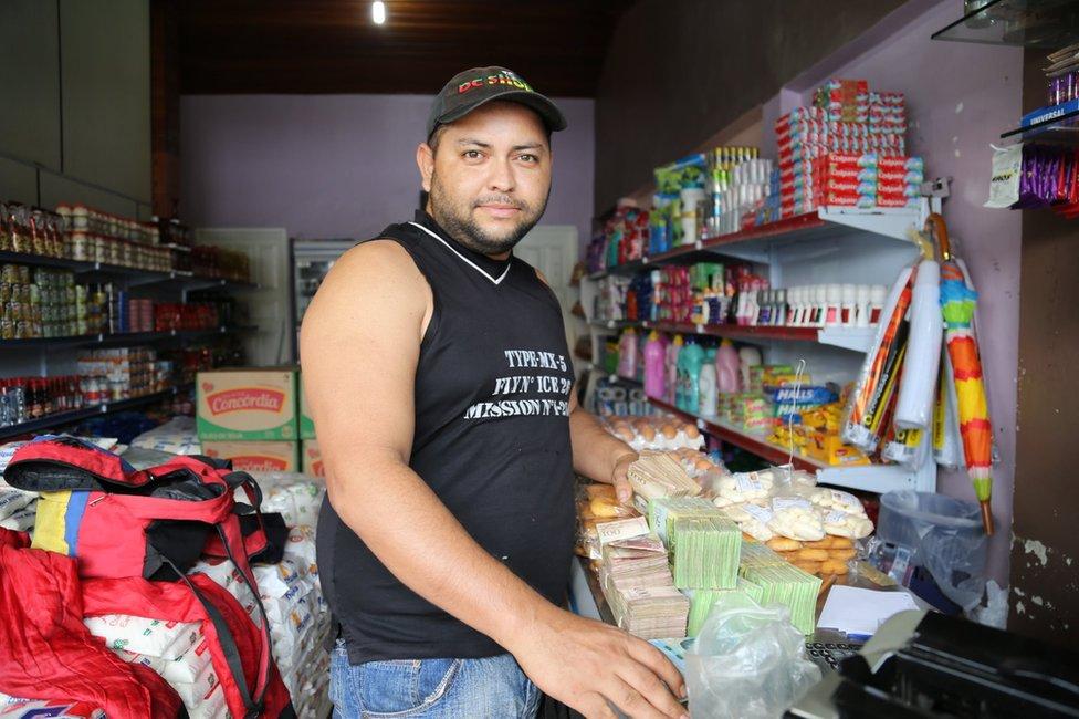 William Camero buys sugar in a shop in Pacaraima
