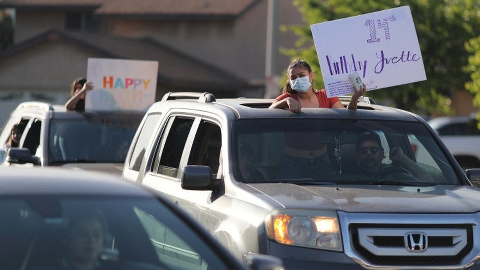 Friends line up to wish Yvette Torres, 14, a happy birthday at a drive-by party outside her home as the global outbreak of coronavirus (COVID-19) continues, in Pico Rivera, near Los Angeles, California, U.S., April 27, 2020