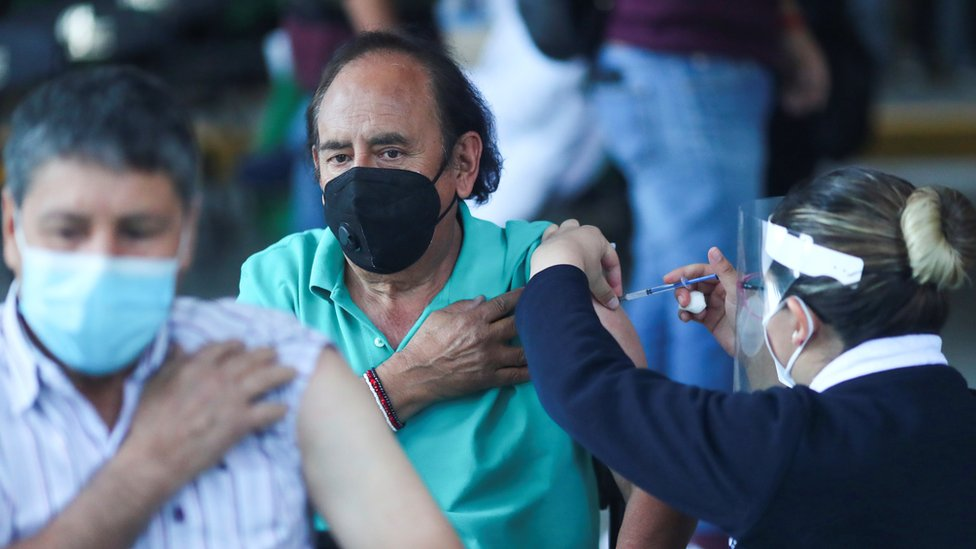 A man receives the Pfizer-BioNTech coronavirus disease (COVID-19) vaccine during a mass vaccination in Mexico City, Mexico March 10, 2021.
